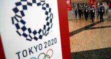 Policiais caminham em principal centro de imprensa dos Jogos Olímpicos Tóquio 2020